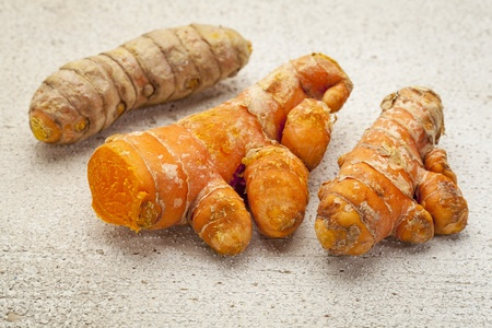 turmeric root on a white painted rough barn wood surface Stock Photo - 19142133