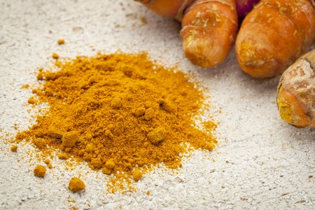 turmeric powder and root on a white painted rough barn wood surface Stock Photo - 19142134