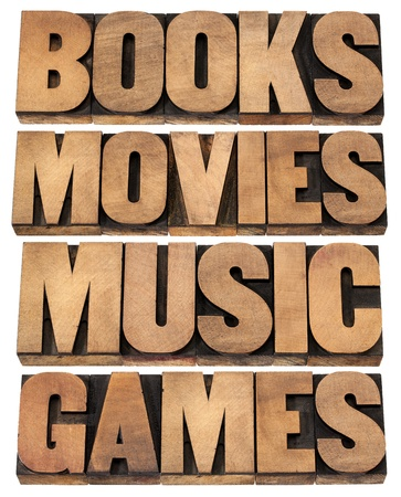 books, movies, music and games  - entertainment concept - collage of isolated words in vintage letterpress wood type printing blocks photo