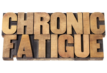 chronic: chronic fatigue - isolated text in vintage letterpress wood type printing blocks Stock Photo