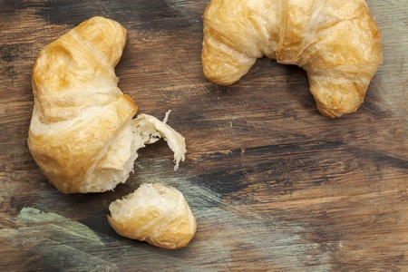 croissant rolls on a grunge painted wood board Stock Photo - 19323231