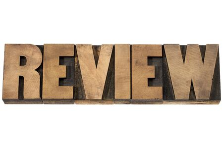 commentary: review word typography - isolated text in vintage letterpress wood type printing blocks