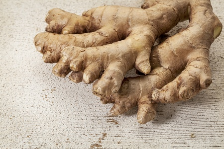 ginger root on a rustic white painted barn wood background Stock Photo - 19497061