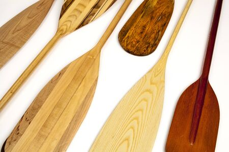 canoe paddle: blades of wooden canoe paddles, different shapes and sizes,  on white background