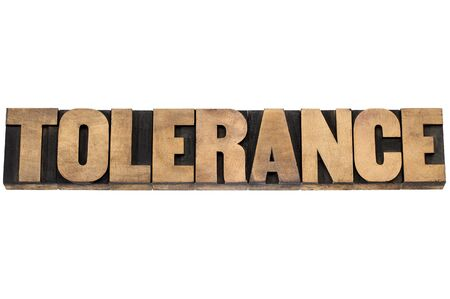 tolerance: tolerance word - isolated text in letterpress wood type printing blocks