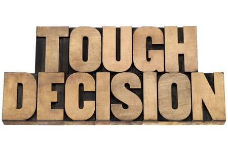 tough: tough decision - isolated text in letterpress wood type printing blocks