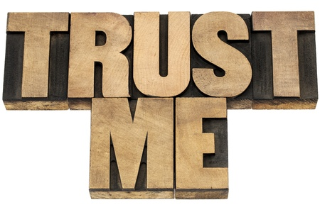 trust me - isolated text in letterpress wood type printing blocks Stock Photo - 19877715