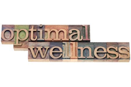 benessere ottimale - concetto di salute - testo isolato in blocchi di stampa tipografica Tipo di legno