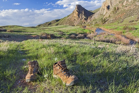 eagle nest rock: hiking boots on a trail -  Eagle Nest Rock Open Space in Colorado at springtime Stock Photo