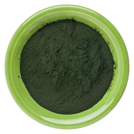 small bowl of Hawaiian spirulina powder isolated on white