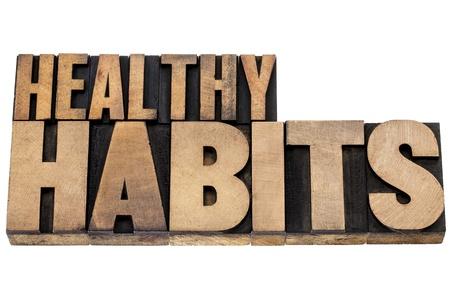 habitos saludables: hábitos saludables - concepto de wellness - aisladas tex en tipografía vintage tipo de madera Foto de archivo