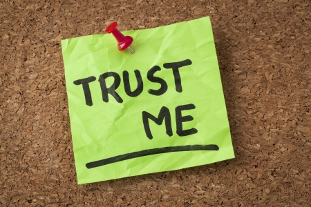 trust: trust me message or reminder  - handwriting on green sticky note Stock Photo