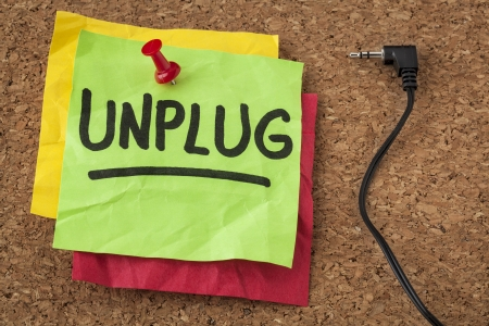 unplug: unplug  - lifestyle or information overload concept  - handwriting on colorful sticky notes