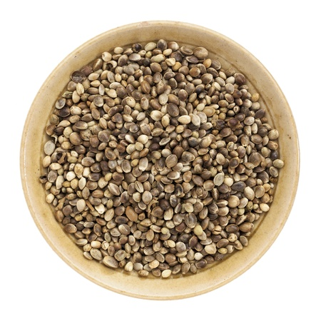 whole hemp seeds in a small bowl isolated on white, top view Stock Photo - 20300402