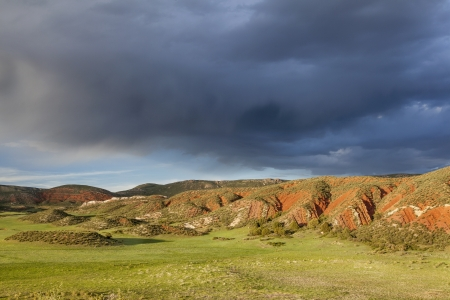 heavy storm clouds over mountain ranch - Red Mountain Open Space near Fort Collins, Colorado, spring scenery Stock Photo - 20300416