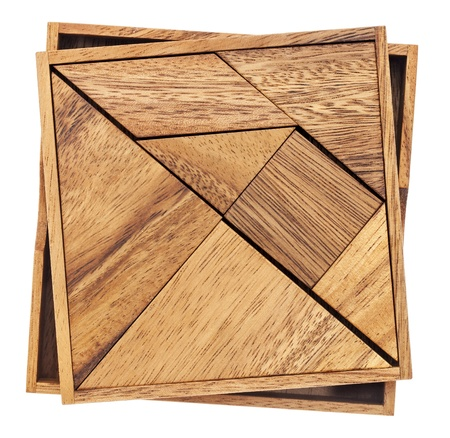 Tangram, a traditional Chinese Puzzle Game made of different wood parts to build abstract figures from them, isolated on white Stock Photo - 20300414