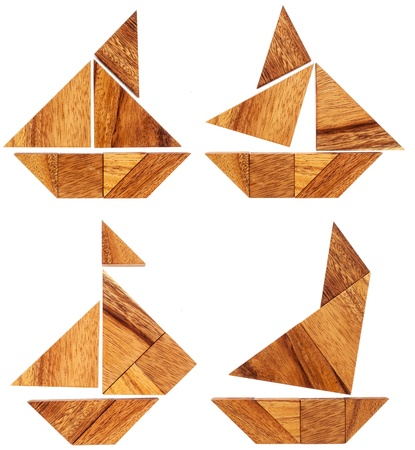 brainteaser: four abstract pictures of sailing boats built from seven tangram wooden pieces, a traditional Chinese puzzle game Stock Photo