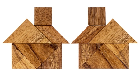 two abstract pictures of a house built from seven tangram wooden pieces, a traditional Chinese puzzle game Stock Photo - 20300424