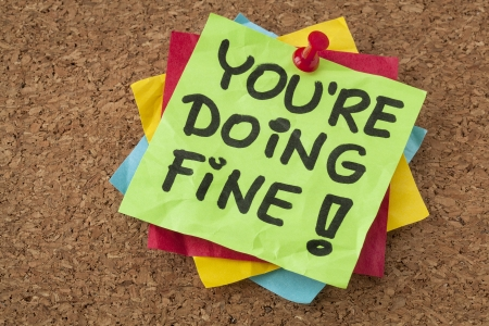 self assurance: you are doing fine - self assurance reminder or compliment - handwriting on green sticky note