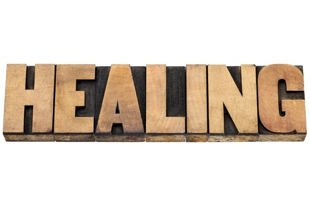 healing word  - isolated text in letterpress wood type