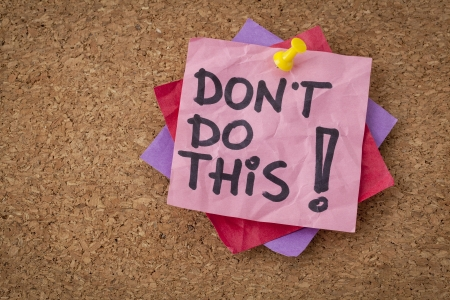 do not do this  advice or warning - handwriting on pink sticky note Stock Photo - 20383164