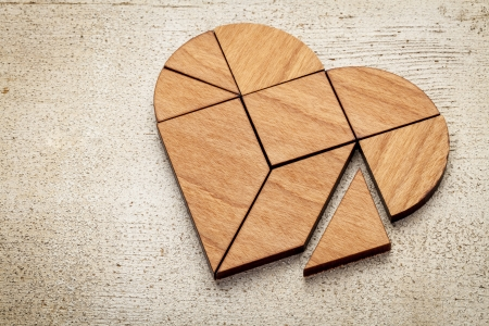 heart version of tangram, a traditional Chinese Puzzle Game made of different wood parts photo