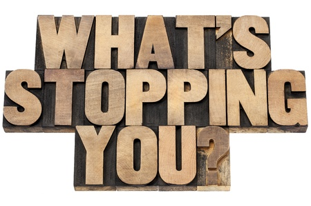 self development: what is stopping you question  - isolated text in letterpress wood type