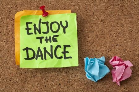 enjoy the dance - a motivational reminder on a sticky note Stock Photo - 20440001