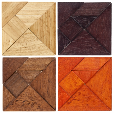 four tangram squares in different wood,  a traditional Chinese puzzle game Stock Photo - 20440006