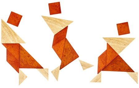 three abstract figures of a dancer or perhaps martial artist built from seven tangram wooden pieces, a traditional Chinese puzzle game Stock Photo - 20439995