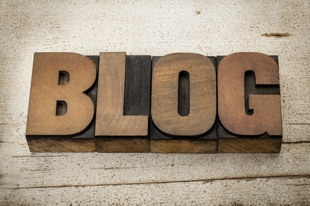 blog - a word in vintage letterpress wood type on a grunge painted barn wood background Stock Photo - 20440015