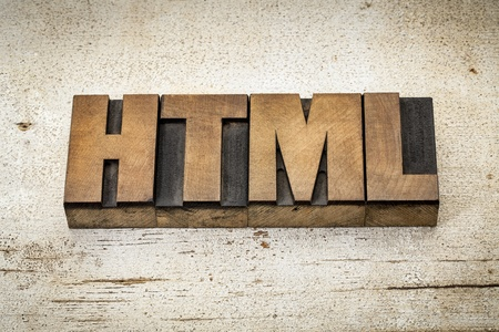 html: html (hyper text markup language) acronym - a word in vintage letterpress wood type on a grunge painted barn wood background