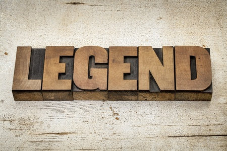 legend word in vintage letterpress wood type on a grunge painted barn wood background Stock Photo - 20440017