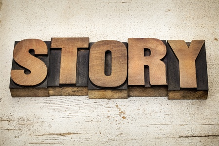 story - a word in vintage letterpress wood type on a grunge painted banr wood background Stock Photo - 20440016