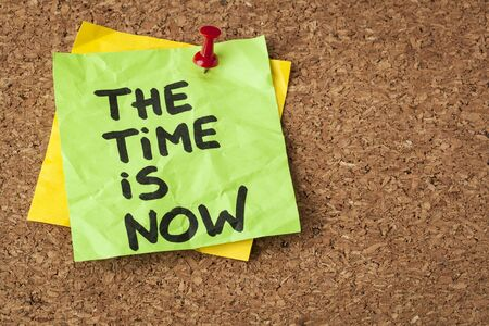 the time is now - motivational reminder on a green sticky note Stock Photo - 20461865