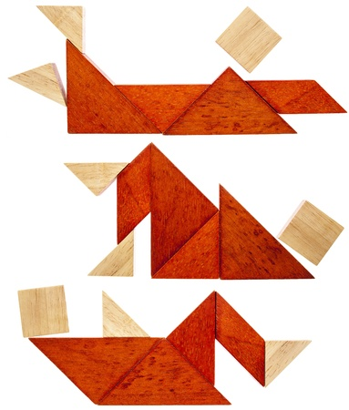 three abstract figures lying down and resting  built from seven tangram wooden pieces, a traditional Chinese puzzle game Stock Photo - 20471538