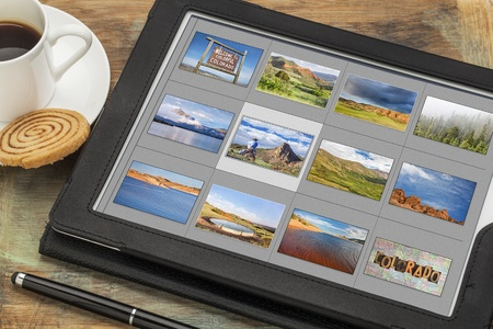 reviewing image library (grid of thumbnails) on a digital tablet computer -colorful Colorado, lakes and mountains, all displayed pictures copyright by the photographer