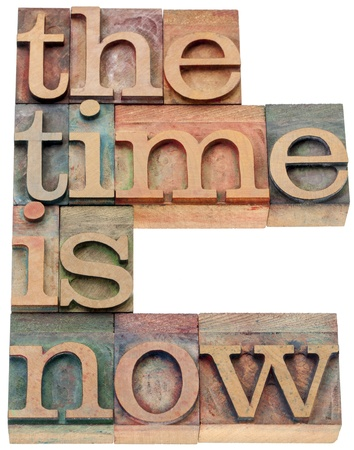 the time is now - motivational concept - isolated text in letterpress wood type Stock Photo - 20590322