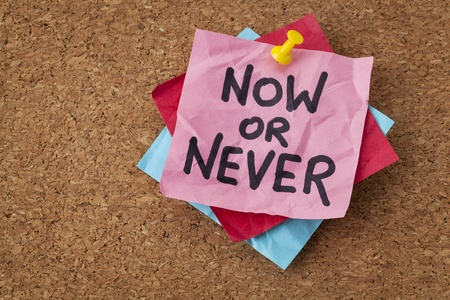 now or never  - motivational reminder on a green sticky note Stock Photo - 20590333