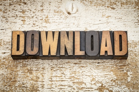 download word in vintage letterpress wood type on a grunge painted barn wood background Stock Photo - 20832283