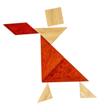 abstract figure of a female dancer or waitress built from seven tangram wooden pieces, a traditional Chinese puzzle game Stock Photo - 20832296