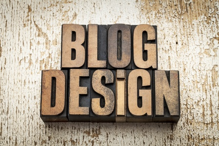 blog design word in vintage letterpress wood type on a grunge painted barn wood background Stock Photo - 20832354