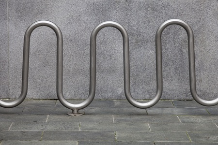 street bike parking - metal racks against gray building wall and pavement Stock Photo - 20832410