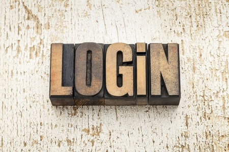 login word in vintage letterpress wood type on a grunge painted barn wood background Stock Photo - 20832417