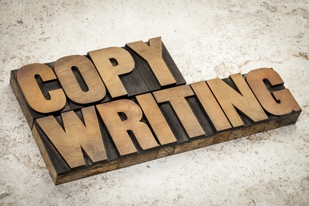 copywriting: copywriting  word in vintage letterpress wood type on a ceramic tile background