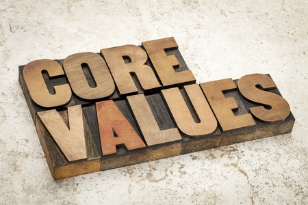 core values - ethics concept - text in vintage letterpress wood type on a ceramic tile background Imagens