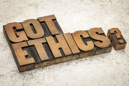 Got ethics question - text in vintage letterpress wood type on a ceramic tile background