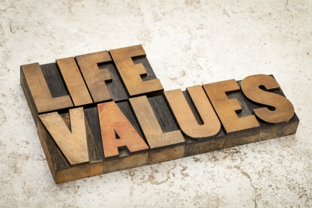 life values words in vintage letterpress wood type on a ceramic tile background photo