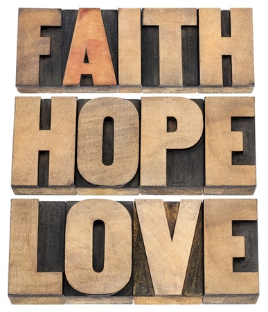 faith, hope and love - a collage of isolated words in vintage letterpress wood type photo