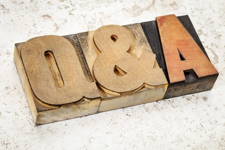 prinitng block: questions and answers i- Q&A acronym - text in vintage letterpress wood type on a ceramic tile background Stock Photo